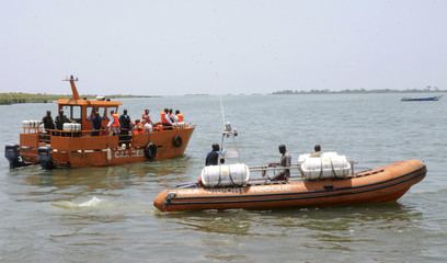 Ugandan civil aviation officials and rescue boats search for the cargo aircraft that crashed into Lake Victoria after taking off from Entebbe international airport Uganda