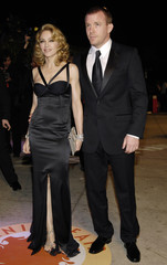 Guy Ritchie and Madonna arrive for the Vanity Fair Oscar Party at Mortons in West Hollywood