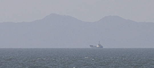 North Korean fishing boat is seen in this picture taken from Yeonpyeong Island near western maritime border between the two Koreas