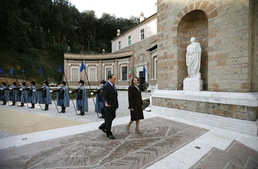 Italy's Prime Minister Silvio Berlusconi and U.S. Speaker of the House Nancy Pelosi arrive for a meeting at Villa Madama in Rome