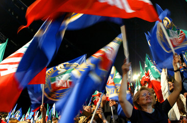 FORZA ITALIA SUPPORTERS WAVE FLAGS DURING THE SECOND FORZA ITALIA NATIONAL CONGRESS IN MILAN.