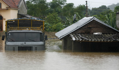 House and a truck are seen in a flooded area in Nghia Dan district in Vietnam's central Nghe An province