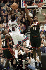 VANCOUVERS MICHAEL DICKERSON GOES UP AGAINST SEATTLES VIN BAKER.