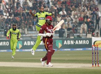 Pakistan's Rana Naved celebrates dismissal of West Indies' captain Brian Lara during third one-day international cricket match in Lahore