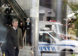 People are seen inside the lobby of One World Financial Center building after a suspicious white powder substance was found in envelopes in the mailroom of the Wall Street Journal in in New York