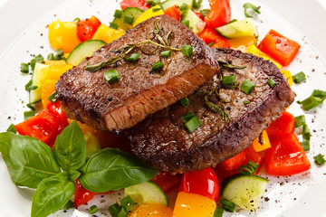 Grilled steaks with vegetables