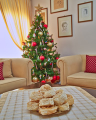 "Greek Christmas ""Diples""  traditional sweet delicacy, and Christmas tree bokeh"