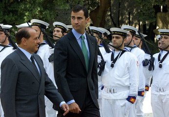 SPAIN'S PRINCE FELIPE PASSES A MILITARY HONOUR GUARD TOGETHER WITHBERLUSCONI.