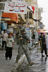 US army soldier with the 10th Mountain Division patrols the main market in Mahmudiya