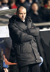 Coach of Paris Saint-Germain Le Guen looks on during their soccer match against Olympique Lyon in Lyon