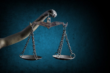 Lady Justice's and holding Scale of Justice isolated on grunge background