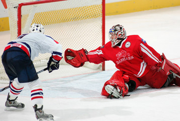 Slovenia's Terglav scores against Denmark's goaltender Hirsch in relegation ice hockey match at ...