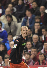Valencia's Mathieu celebrates a goal during their Spanish First Division soccer match aganist Athletic Bilbao in Bilbao