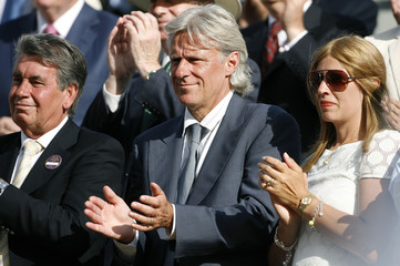 Former Wimbledon champions Borg and Santana applaud after watching men's singles final match between Switzerland's Federer and Spain's Nadal at the Wimbledon tennis championships in London
