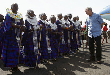 US President George W. Bush watches dancers perform during a welcoming ceremony at Kilimanjaro International Airport in Arusha