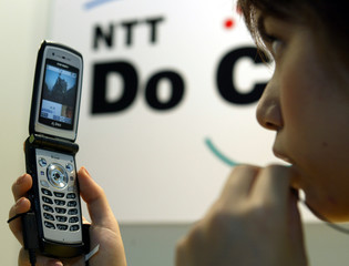 NTT DOCOMO DEMONSTRATES AN INTERNATIONAL VIDEOPHONE SERVICE AT THE WPCEXPO IN CHIBA, NORTHEAST OF TOKYO.