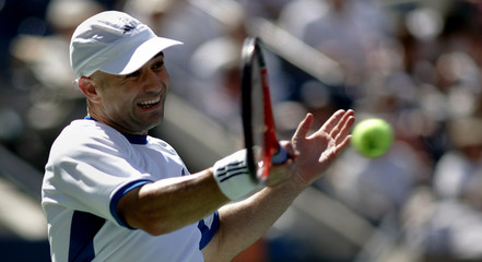 Andre Agassi of the US hits a return to Xavier Malisse of Belgium at the US Open tennis tournament in ...