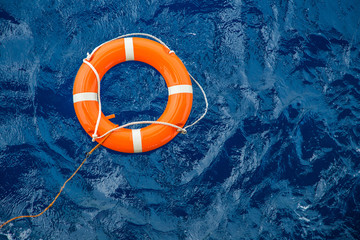 Safety equipment, Life buoy or rescue buoy floating on sea to rescue people from drowning man. Wall mural