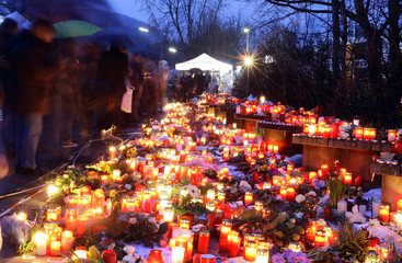 Mourners gather in front of the Albertville-Realschule school where a shooting incident took place in Winnenden