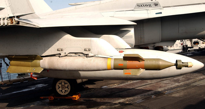 A laser guided 500 lb bomb attached to an F/A-18C Hornet aboard the US Navy aircraft carrier USS Abr..