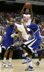 Ohio State University Buckeyes' Lewis goes to the basket against University of Memphis Tigers' Anderson and Douglas-Roberts in their NCAA men's South Regional final basketball game in San Antonio