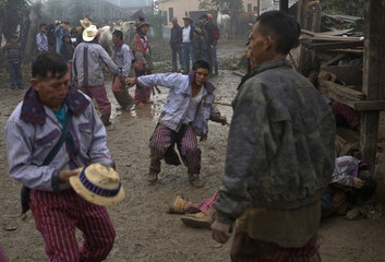 Riders finish a night of drinking alcohol and dancing before a traditional horse race on All Saints Day in Todos Santos