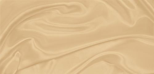Smooth elegant golden silk or satin luxury cloth texture as wedding background. Luxurious...