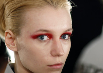 A model has eye makeup applied before the Ports 1961 Spring 2010 show during New York Fashion Week
