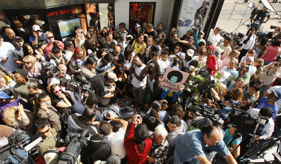 Fans and media surround Michael Jackson's star on the Hollywood Walk of Fame in Los Angeles