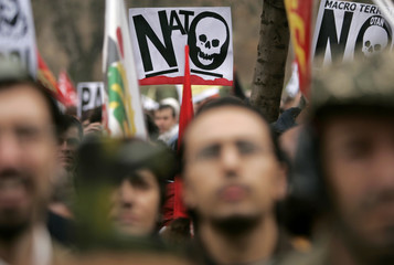 Protesters attend a demonstration against NATO in central Seville