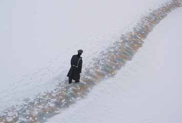 A police officer patrols a street after heavy shower of snow in Lanzhou China's midwest Gansu province