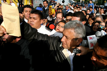 Lopez Obrador, presidential candidate of PRD, departs after casting his ballot at polling station in Mexico City