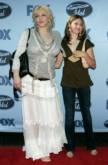 """Rock star Courtney Love (L) and her daughter Frances Bean arrive at the finale of Fox's """"American Id.."""