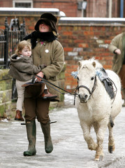 Members of the public turn out to watch the annual Boxing Day Cheshire Hunt meet depart in Tarporley Cheshire.