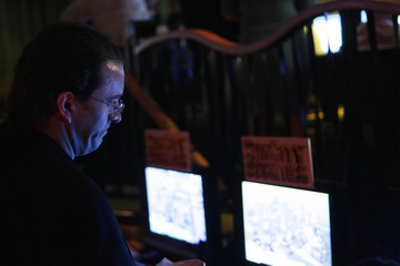 """A journalist listens to a presentation about the game mechanics of the title """"SimCity Societies: Destinations"""" at an Electronic Arts demonstration in New York"""