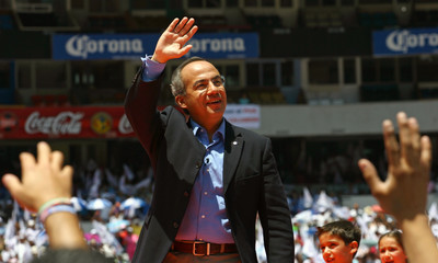 Calderon, presidential candidate for National Action party, waves at his campaign closing rally in Mexico City