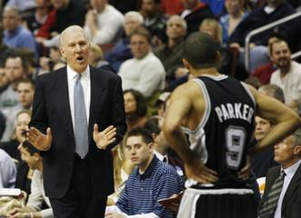 Spurs head coach Popovich shouts instructions to Spurs guard Parker in Philadelphia