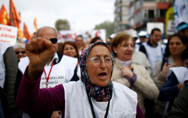 A woman shouts slogans as people arrive to attend a May Day rally in Istanbul
