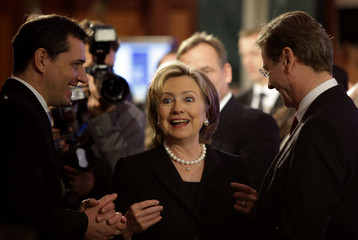 German Foreign Minister Guido Westerwelle introduces his partner Michael Mronz to his U.S. counterpart Hillary Clinton during the Atlantic Council Awards ceremony at the Adlon hotel in Berlin