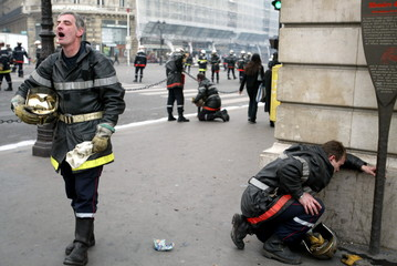 Professional firefighters suffer from tear-gas during clash with riot policemen near place de l'Oper..