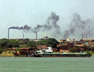 Smoke rises from small factories on the bank of river Hooghly in Calcutta.