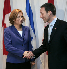 Israel's Foreign Minister Livni shakes hands with Canada's Foreign Affairs Minister MacKay in Ottawa