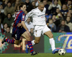 REAL MADRID'S RONALDO AND EIBAR'S ALANA BATTLE FOR THE BALL DURING THEIR KING'S CUP SOCCER MATCH IN MADRID.