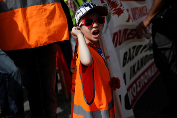 A boy shouts slogans during a rally organised by the communist-affiliated PAME union commemorating May Day in Athens
