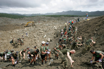 Philippine soldiers and US marines dig up earth while searching for victims in southern Leyte