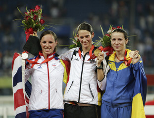 Silver medallist Fell of Britain, gold medallist Schoeneborn of Germany and bronze medallist Tereshuk of Ukraine pose during medal ceremony of the modern pentathlon competition at the Beijing 2008 Olympic Games