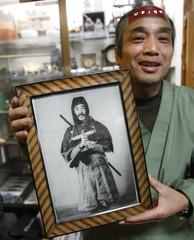 Motoharu Murai shows a picture of his grandfather in Iga