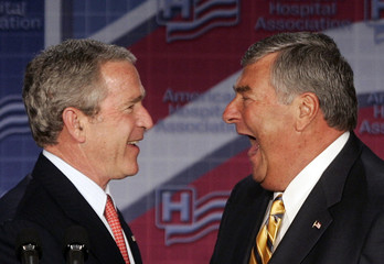 US President Bush shares laugh with Dick Davidson, President of American Hospital Association in Washington
