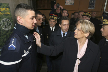 French Interior Minister Alliot-Marie speaks with gendarme, who was injured during a demonstration in the Basque country, during visit at police station in Pau