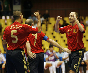 Goncalves of Spain celebrates  with team mate Fernandez after scoring against Argentina during FIFA Futsal World Cup soccer match in Brasilia